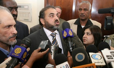 Lord Ahmed, a member of the House of Lords, and Baroness Warsi from Britain's House of Lords address the media in Khartoum