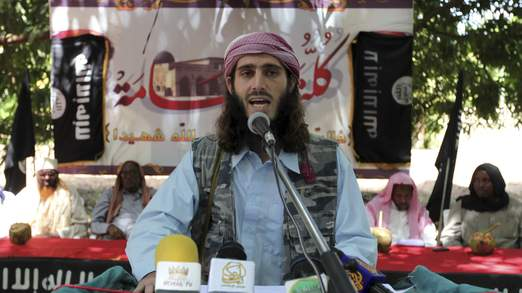 American born Islamist militant fighter Omar Hamami known as Abu Mansur Al-Amriki addresses a news conference at a farm in southern Mogadishu?s Afgoye district