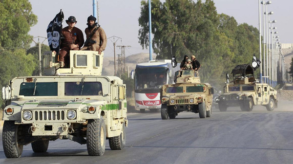 Militant Islamist fighters take part in a military parade along the streets of Raqqa