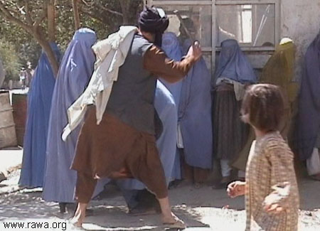 Taliban beat a woman in KabulSep.2001